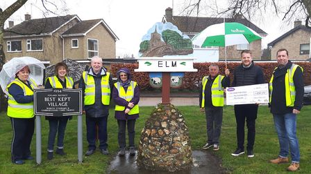 Fenmarc presents £250 to members of Elm Street Pride group to help clean up the village. PHOTO: Subm