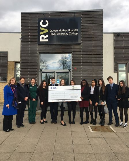 Chancellor's School pupils present a cheque to the Royal Veterinary College for the college's charit