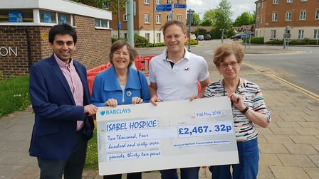 Grant Shapps handing over the cheque to Isabel Hospice representatives. Picture: Welwyn Hatfield Con