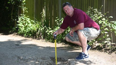 """Local resident Duncan Lewis is calling on the parish council to do more to fix the """"craters"""" in Jona"""