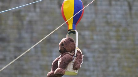 Visitors teddy bears bravely have a go on the zip line to the top of Lemsford church