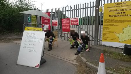 Staff stationed outside Potters Bar waste recycling centre on Sunday during its closure. Picture: su