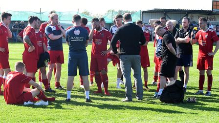 Wisbech boss Gary Setchell addresses his players following their draw against Daventry Town. Picture