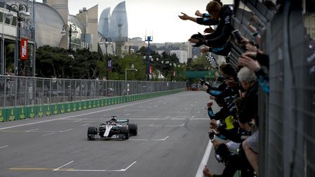 Lewis Hamilton takes the chequered flag in the 2018 Azerbaijan Grand Prix. [Picture: Wolfgang Wilhel