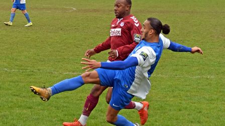 Potters Bar Town's Jordan Lawal puts Quentin Monville under pressure as the Bar Army look on. Pictur