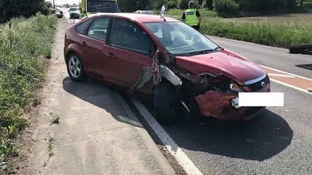 A woman was taken to Peterborough City Hospital with slight injuries after a two vehicle collision t