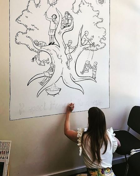 Clara working on the mural. Picture: supplied by Clara Nicolls