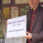 Norman Jacobs Jnr with the plaque to his father.