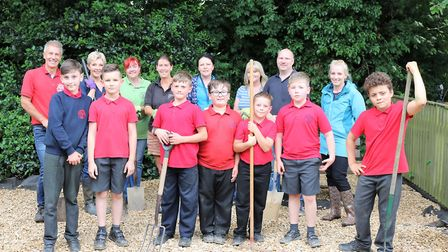 Peckover Primary sprucing up their grounds and being filmed for BBC's Britain in Bloom