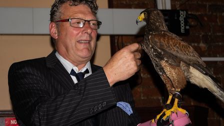 Wisbech Business and Professional Men's Club joined by a Harris Hawk at meeting at Mendi's