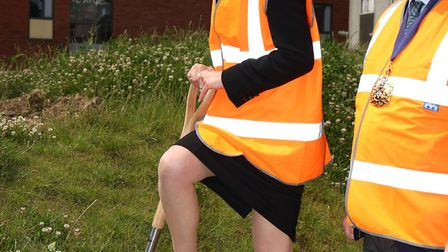 Dame Alice Owen head Hannah Nemko officially starts the breaking ground ceremony with the old buildi