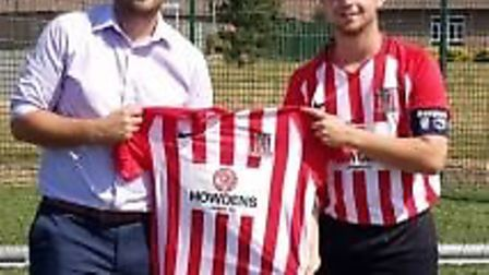 Jamie Robinson, manager of Howdens Joinery Wisbech, attended to present the kit to the reserves capt