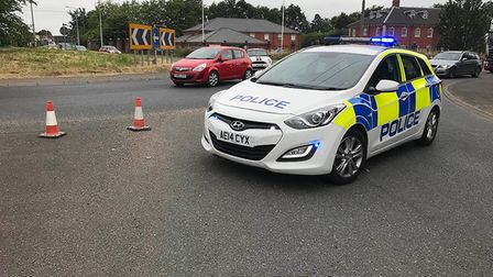 Police at the scene of a road closure following a crash near Elme hall Hotel at Outwell