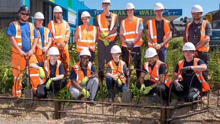 College of West Anglia students – past, present and future (pictured) – have erected a metal fence t