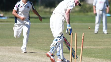 Wisbech 2nds bowler Wian Pretorious claims the wicket of batsman Andrew Wool during their nine-wicke