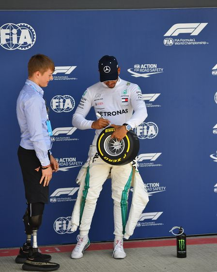 Lewis Hamilton with teenage racer Billy Monger at the 2018 British Grand Prix at Silverstone. Pictur