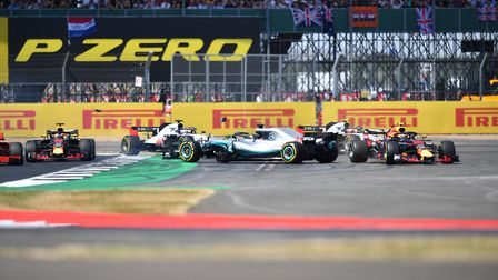 Lewis Hamilton spins on the first lap of the 2018 British Grand Prix at Silverstone after being hit