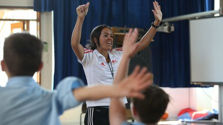 Former GB badminton player Elizabeth Cann runs a workshop with year five and six pupils as part of a