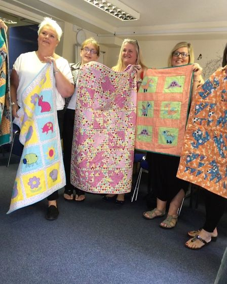 A Wisbech-based sewing group has donated handmade patchwork quilts to a child fostering agency based