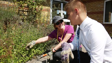 WGC Horticultural society member Wendy Hilton gives some tips to Knightsfield School year10 pupil Ja