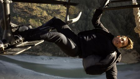 Tom Cruise pulling off just one of dozens of death-defying stunts in Mission Impossible: Fallout. PH