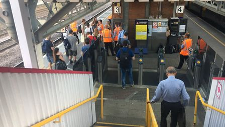 Passengers stranded at Welwyn Garden City station while platform staff work to locate a northbound t