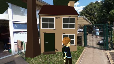 Danny in front of the house - Jacob Nixon of Wisbech hopes to make school lessons more fun and engag