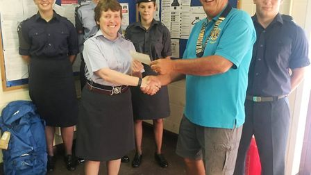 Lion president Chris Gay handed over the cheque to Flight Lieutenant Anne Rose.