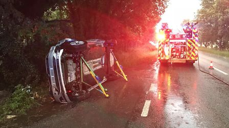 A suspected drink-driver, aged 56, flipped her car onto its side before colliding with a fence near