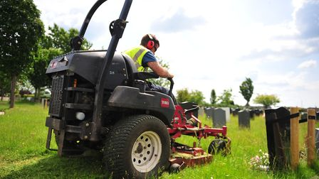 Contractors at work this summer at Eastwood Cemetery in March as the overgrown grass gets cut. Photo