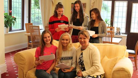Pupils and principal at Queenswood School with their A-level results. Picture: supplied by Queenswoo