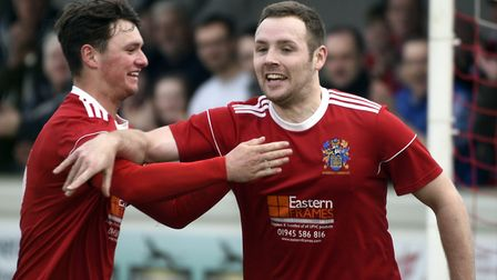 Alex Beck (right) put Wisbech Town ahead in their FA Cup defeat. Picture: IAN CARTER