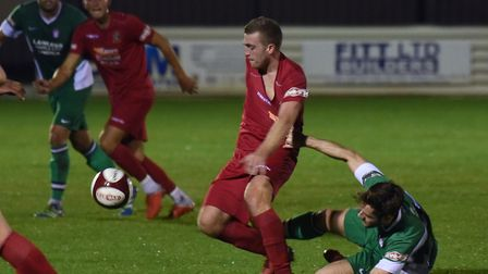 Adam Millson tucked away a late penalty to earn Wisbech Town a draw against Lincoln United. Picture: