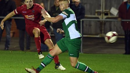 Wisbech Town striker Alex Beck gets in a shot against Lincoln United. Picture: IAN CARTER