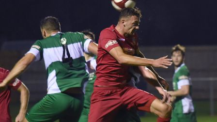 Wisbech Town midfielder Sam Murphy gets his head on the ball against Lincoln United. Picture: IAN CA