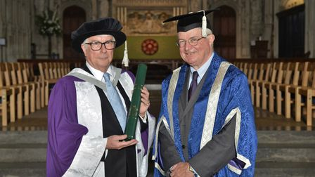 Ken Follett (left) with Chair of the University of Hertfordshire's Board of Governors, Richard Beazl