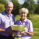 Willow co-founders Bob and Megs Wilson with the Willow Senior Golf Classic Cup. Picture supplied by