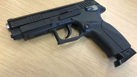 This black BB gun has been seized after it was discovered in Wisbech. Picture: CAMBS POLICE