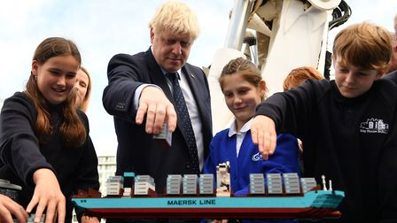 Prime Minister Boris Johnson takes part in an activity with school children as he visits the NLV Pha