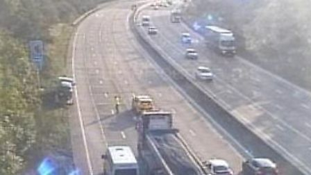 Traffic being stopped by police officers on the M25 between junctions 24 and 25. Picture: www.motorw