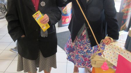 Sisters enjoy a game of hook a duck at Morrison's in Wisbech. At the age of 102 and 93 they are stil
