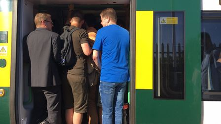 Commuters squeeze onto a London-bound train after cancellations this summer. Picture: Mia Jankowicz