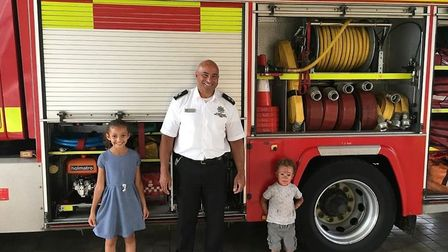 Tia and Reggie with watch commander James Thompson during their private tour of Wisbech fire station