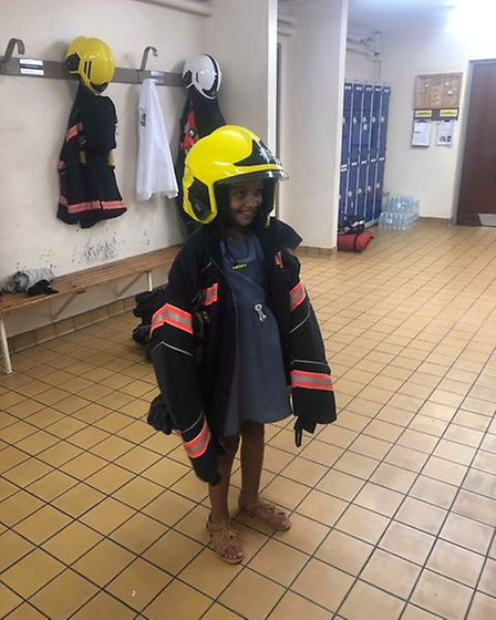 Tia tried on one of the fire crew's outfits during her private tour of Wisbech fire station.