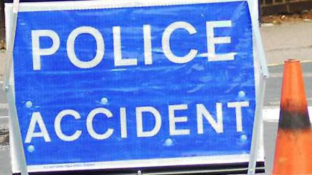 A police warning sign at the scene of an accident
