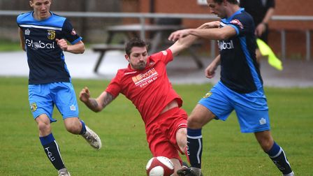 Ollie Gale slides in to make a tackle during Wisbech Town's defeat against Tadcaster Albion. Picture