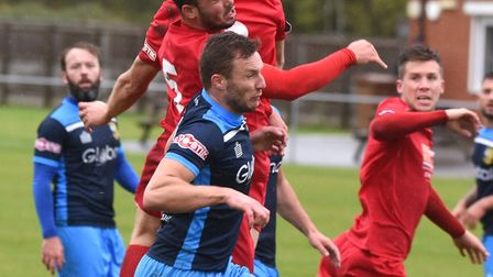 Wisbech Town defender Sam Gaughran gets his head on the ball during their loss to Tadcaster Albion.
