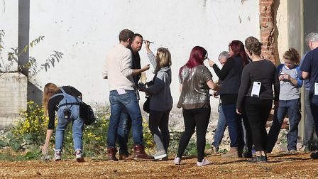 Danny Dyer (left) has his make-up touched-up during filming at the Shredded Wheat factory site. Pict