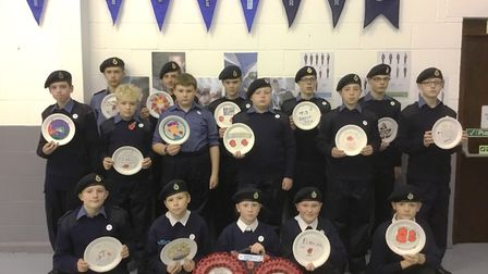 Wisbech Sea Cadets wrote names on 281 poppies copied from Wisbech war memorial and mounted them to m