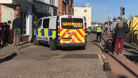 Norwich Street in Wisbech was cordoned off this morning after a man was injured in a work-related in